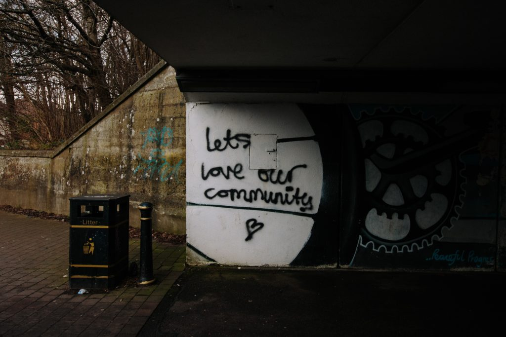 "Graffetti Wall that reads ""Let's Love Our Community"""