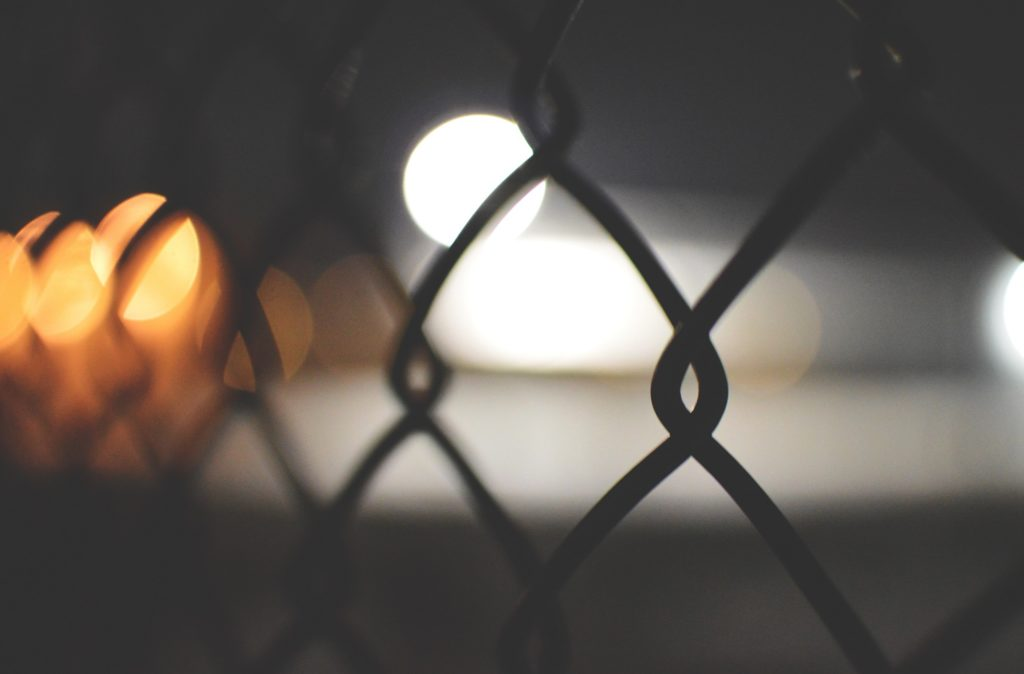 Chainlink fence with blurry lights